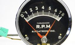 Old speed shop tachometer from the mid' 1960's made by Radatron INC in North Tonawanda NY USA, face 3 1/4 inches with small chrome housing great for steering column mounting. 8000 RPM with shifting pointed needle, for 8 cylinder cars 6 or 12 volts. Chrome