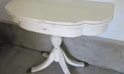 """Nice vintage console table that folds open. Originally a bridge table. Has a small compartment in the top. Painted antique white, distressed, and waxed. Measures 36"""" wide X 18"""" deep, and 30"""" tall when closed. Expands to 36"""" X 36"""" when open. Mirror in"""