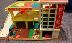 Yes, this is the one from when you were a kid. Pretty good shape for an old toy. Fun to use with hot wheels cars. Car elevator dings a bell, wind up car hoist works. Paper not glued down (we took it off so it wouldn't get damaged with play)