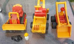 THE 3 TRACTORS ARE IN GOOD CONDITION THE MOVING PARTS ARE IN VERY GOOD CONDITION STILL WORKING VERY WELL. LENGTH 11 INCHES 10 1/2 INCHES 10 INCHES