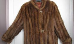 Classic bell shaped muskrat fur jacket falls just below the waistline. Folded over cuffs and small round collar, richly coloured lining and ornate buttons, all beautiful details. It's a size 10. In good condition. Hasn't been worn for over 20 years. Local