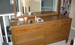 I am offering a vintage Gibbard dresser for sale.   It is a full length dresser with 4 big drawers and 3 smaller drawers. The mirror on top is in good shape and not cracked anywhere.