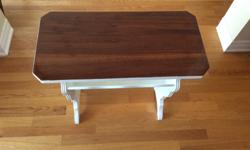 Restored wood table with lower shelf to store papers ,magazines, odds and ends. Top is light Colonial colour with semi-gloss finish. Bottom is finished in ultra pure white flat enamel. 24 inches high, 24 inches wide, 11.5 inches deep. Really nice moldings