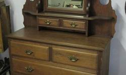 """Circa 1900. Mahogany 4 drawer dresser with small upper shelves, 2 drawers and tilting mirror. Has a few marks but otherwise condition is good. Measures 45"""" X 18"""" X 75"""" tall. Call or text, and if you email please leave name and phone number."""