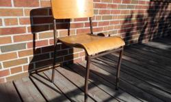 Perfect for your industrial modern decor. One sturdy original iconic chair of the mid century often seen in schools, community theatres and church basements. Good condition for its age with one nick in the side of the seat and wear on the seat (see