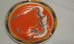 Dragonware plate from the 1940s. Dragonware is also known as Moriage or Cloisonne. There are a couple of 1 millimeter spots where the blue enamel around the rim has chipped. Otherwise, it is free of chips, cracks, or other flaws. Pick up only. $15 firm.