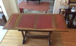Extendable oak table measuring 30x42 and 30x60 extended. 30 inches high. Table leafs store within the table frame for easy conversion. Not sure of table design or origin, library table, trestle mission, trestle Amish??? Middle of table and leafs have