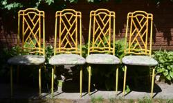 Bamboo pattern on backs of chairs in plastic Strong metal frames Seats easily recovered with your favourite pattern Good condition except seat covers Very sturdy $125.0 for 4 chairs