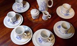 "This vintage porcelain child's tea set is for six people and has a lovely Asian inspired ""classic blue bird"" design. It is in blue and white and includes a teapot, cream and sugar, plates, cups and saucers, and plastic cutlery in light blue. The set still"