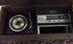 Price reduced!! One of the coolest pieces of furniture in the house...over 30 years old, it has a radio, record player AND A-track player! Have seen similar online for several hundreds of dollars but this one is in mint condition and the radio and