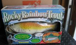 """Vintage Rocky Rainbow Trout the singing sensation. Motion activated. Rocky flaps his tail while singing """"Wild Thing"""" and """"Please Release Me"""". Requires 4 C batteries (not included) Wall hanging or Desk top NEW in the original box (new old stock)"""