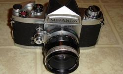 50mm F/1.9 Prime lens. Vintage Miranda DR 35mm film camera with a 50mm F1.9 lens. This unit is in excellent working and cosmetic condition with only minor signs of use as you can see from the pictures. This little gem would make a great addition to your