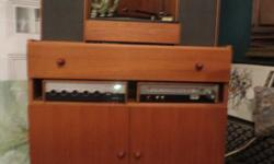 Thank you for your interest in our Vintage Stero. - Working Stero and Record Player with Two Speakers - Solid Teak Cabinet to Fit - Excellent Condition - Measures: 27.5 inches H, x 31 inches W, x 16 inches D If you have any questions, please don't