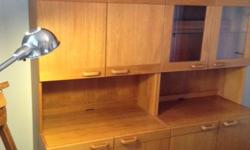 """Selling two beautiful teak bookcases, each 32""""w, 71h"""", 25d"""". One has glass doors and a glass shelf in the upper section complemented with built in display lights and the other has shelves and a door. They are both in as new condition and would be a lovely"""