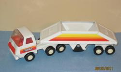 """Vintage Tonka Belly Dump - made of pressed steel, excellent condition, bottom door opens. You don't see too many this color. Measures 9.25"""" Long."""