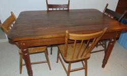 VINTAGE WOOD DINING SET AND 4 CHAIRS THE IS 54 IN, LONG BY 35 IN. WIDE AND 30 IN. HEIGHT THE TABLE DOES NOT SPLIT OPEN THE LEGS CAN BE REMOVE FOR TRANSPORTATION IN VERY GOOD CONDITION