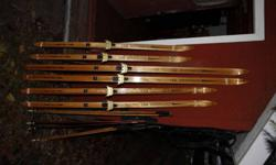 Vintage, wooden, x-country skis.  Made in Sault Ste. Marie.  $30/pair 3 pairs available - 3 different lengths (see pictures)  traditional 3 pin bindings Bamboo poles available for $10/pair