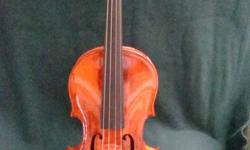 This would make a lovely Christmas gift!!! Antique violin made circa 1914.  Suitable for a progressing student. Nice inlaid purfling front and back, ebony fingerboard and pegs. Two labels inside: Label#1:  Copy of, Antonius Stradiuarius, Made in Germany.