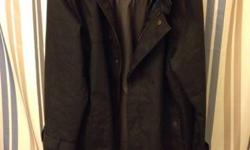 Black Volcom Lido trenchcoat-style spring jacket with zip-in liner. Outer layer goes halfway to knee on 6-foot person. Liner is lightweight grey windbreaker with stripey pattern. Inside of black jacket is teal when liner is removed. Lots of pockets.