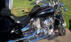 I have a 2002 Yamaha Vstar 1100 In mint shape . Has a new front tire an new brakes . Vance hines pipes sounds nice ! Tach clock flat boards front an back . Lots of extra chrome ! 3700 $ Hard leather bags studded seat an back rest . Would trade for an
