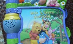 VTech Slide 'N Learn Storybook Winnie the Pooh * Eight-page story about Winnie the Pooh and his friends teaches songs and spoken story content * Interactive pages with sliding, turning and peek-a-boo elements engage baby in play * Light-up beehive