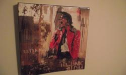 Wooden wall hanging depicting Michael Jackson. Is in perfect condition and measures approx 15.5x16 inches and just under 2 inches deep. Only selling due to moving. Message if interested!