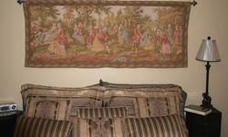"""Coloured Wall Tapestry of an old French garden party scene.   68"""" wide. 28"""" deep. Excellent condition. Was bought at an auction several years ago.   The mouting rod and hardware are NOT included."""