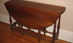 """One walnut gate leg table in good condition. Opens to 48"""" Fold to 12"""""""