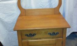 """Old washstand, still has wood wheels and door has an old repair. Size 24"""" wide x 17"""" deep x 26.25"""" tall in front, 47.5"""" tall in back.   OBO"""