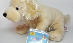 New Webkinz American Golden Spaniel with sealed code. Comes with Sparkle Denim Purse. The purse looks like new but the codes are gone.