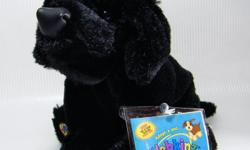 """Super cuddly Webkinz Black Lab has a soft vinyl black nose and velvety soft body weighted at the feet and rump. Measures approx 9"""" long from tip of nose to the rump, when laid flat, and just over 6"""" from the top of the head when in sitting position. New"""
