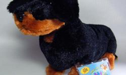 """Webkinz Dachshund with a plastic black nose and 2-tone body with black and tan. Measures approx 10"""" long and stands about 6.5"""" high. New with Sealed Code. Excellent condition for display or play. From a smoke free home. Thanks for looking."""