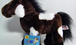 """Webkinz plush Pinto pony with Sealed Code. Brown body with white patches; a black mane, tail and hooves. Approx 8"""" to the top of the head, 10"""" long from nose to hind foot."""