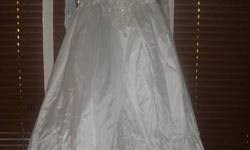 Wedding Dress With train, Size 16. Was never used. Still in original packaging. Cost over $1000.00. Only asking $99.00 or make an offer. Dress must go, been hanging on to it too long. beautiful new dress for someone on a budget and  doesn't want to wear