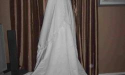 This is a gorgeous wedding dress. It is white. Worn once. Size 6.
