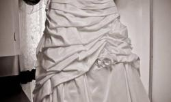 I am selling my wedding dress , I wore it for 5 hours. Its a amazing dress, as  soon as I put it on, I lost 50lbs, sooo slimming. I paid $1350 for the dress, selling  for $700 OBO. The dress has a train that you can bustle up for the recption. It will fit