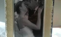 For Sale is an ?Our Wedding Day? photos album.   It can hold 100 +1 4x6 photos, and 1 DVD slot. The front cover can use as a photo frame. It is new, never used.  The front cover looks so elegant.  A wonderful wedding gift for friends or for yourself.