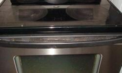 Whirlpool gold flat top stainless steel stove,self clean oven,in very good condition and with warranty.$ 499 For more appliances please go to www.accappliances.webs.com  Please contact us at 613 864 5307 before coming.  ACC Appliances Ltd