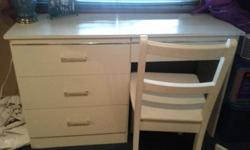 I have a white desk & chair for sale - $40 45.5 in wide/ 24.5 in high available immediately call Jenn @ 519-865-6404