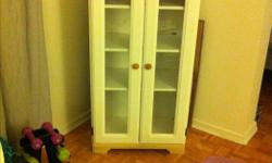 White cabinet with two glass doors. Three removable shelves. Top has some wear, nothing a coat of paint won't fix. Dimensions are 4 ft H X 23 in W X 15 in D No Delivery