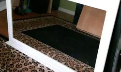 White bathroom mirror in good condition. Measures 46 in wide by 31 in high. Needs touch up paint on side of frame.