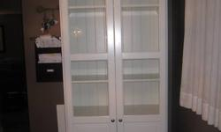 """1 year old Ikea Liatorp -White 6 shelf -bookshelf with glass doors..still sold at Ikea..Bookshelf sells for 349. and glass doors are 180. for the pair..used as cabinet in dining room..Excellent condition. 13.5"""" depth x 35"""" width x 7 ft height. Very nice"""
