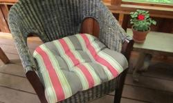 Stylish wicker chair with cushion.  Almost new.