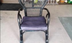 Black wicker chair with cushion. Contact Helen/Bob