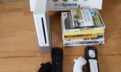 Wii console, 2 controllers, 2 nunchucks, 5 games, Wii Sports, Tiger Woods PGA 08, Star Wars The Clone Wars Republic Heros, Medal Of Honor Vanguard, Call Of Duty 3, Call Of Duty Modern Warfare 3.