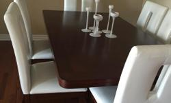 """HomeElegance wine dining table 6ft, + extension 24"""". has a nice Nice wine rack storage unit under the table. 6 chairs"""