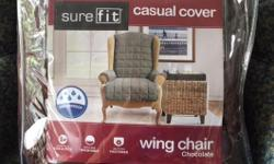 Wing chair cover, chocolate, new in bag (has not been used). Machine washable, button fasteners, original price $40.