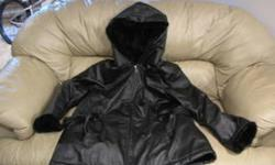 Ladies genuine leather lined hooded 3/4 length winter coat, Black, size 3X Worn once bought new $395 US O.B.O. txt 403-308-2006