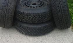 4 Winter Tires on rims size 14 Used 1 winter in great shape