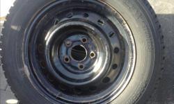 Winter tires with rim from a nissan car, size 215-60-16 Toyo brand.
